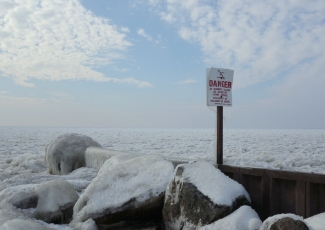 Lake Erie frozen with snow