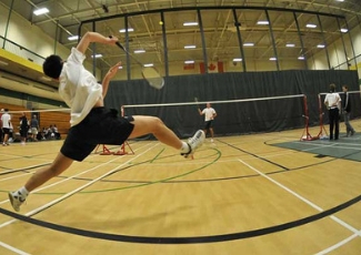People playing badminton in the gym in the Leamingotn Recreation Centre