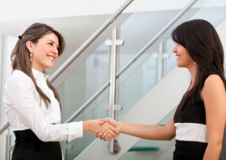 Tow Business Women Shaking Hands