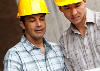 Two men in construction hats